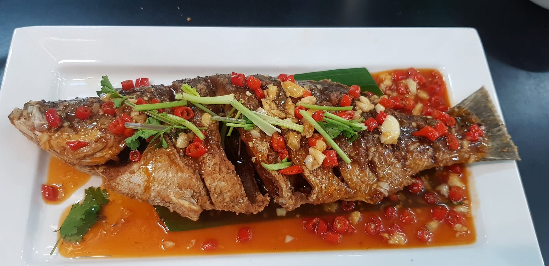 Fresh Seabass served with chillis